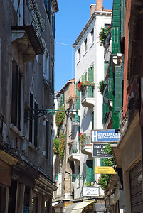 Typical Street in Venice with shops on ground level & apartments on upper floors