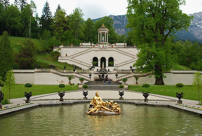 """Fountains and statues at Schloss Linderhof.  This water parterre in front of the castle is dominated by a large basin with the gilt fountain group """"Flora and puttos"""""""