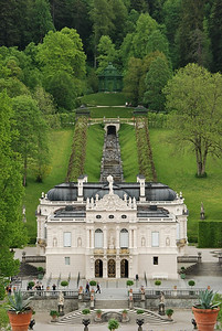 Linderhof; the back grounds consist of a music pavilion, stair step water fall and grape vines.