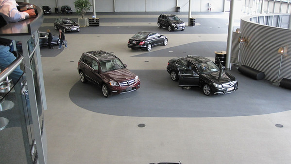 New Mercedes vehicles ready to meet their new owners at the Mercedes delivery center.