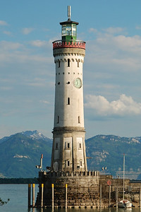 Light house at Lindau with Switzerland in the background.
