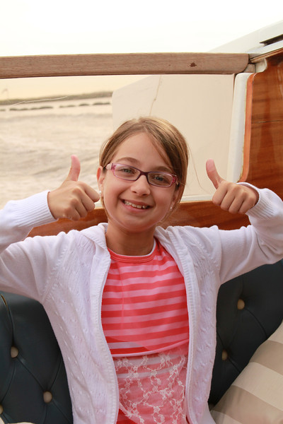 Kate gives the water taxi a thumbs up.