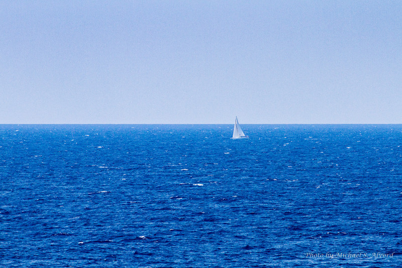 We are out in the middle of the Mediterranean we see this small sailboat going in the other direction. I'll stick with our boat.
