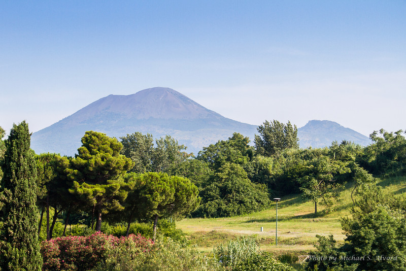 That is Mount Vesuvius which errupted in 79 AD and distroyed Pompeii.