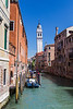 Looking down one of the canals. The white tower in the distance is on of the two leaning towers of Venice.