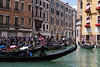 Old meets New. One of the gondoliers on his cell phone.