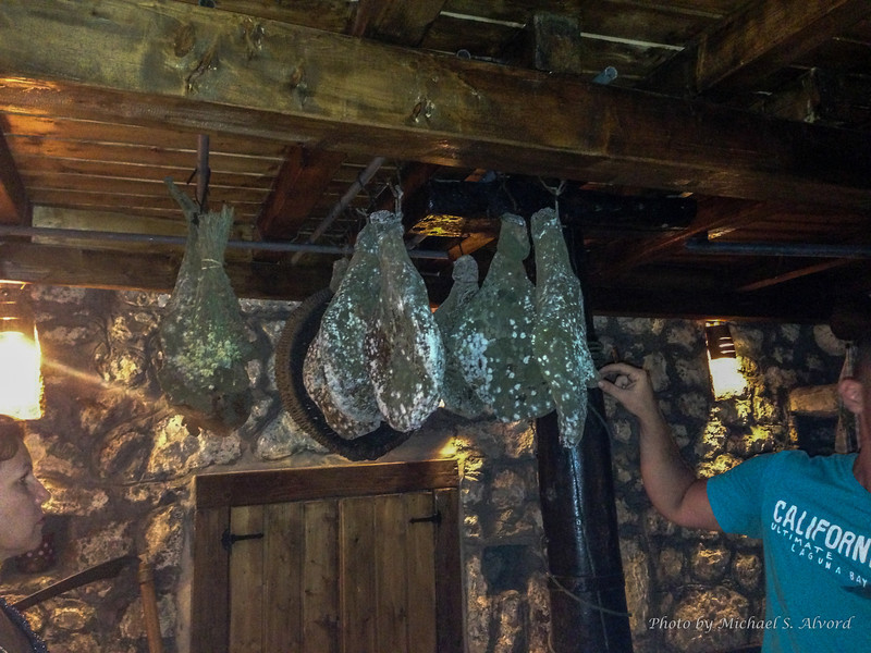 They age their own hams by hanging them in the olive mill.