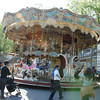 The antique carousel in the park.
