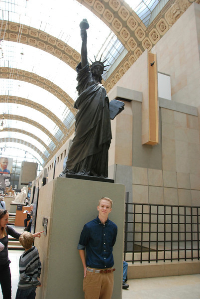 Jeremy with a replica of the Statue of Liberty.
