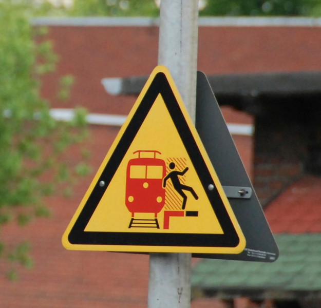 "Monday, May 26: On the way to Cologne. This is the ""don't stand too close to the train tracks"" sign."