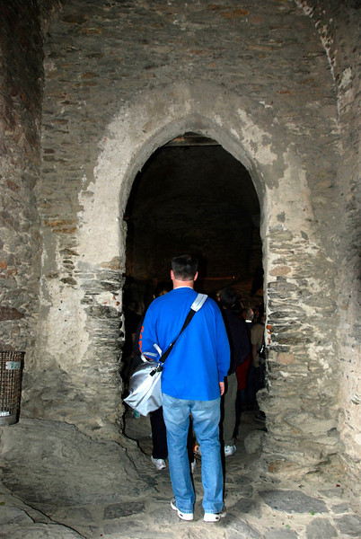 The shape and height of this entrance shows that this room probably was part of the stable. It was high enough for men on horses to ride through.
