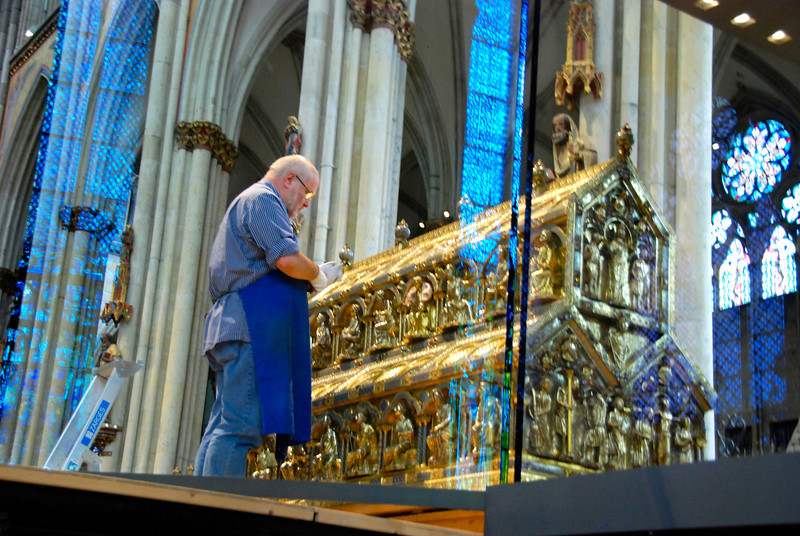 This man is cleaning the Shrine of the Three Kings, believed to hold the relics of the three wise men.