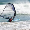 Wind surfing -- he tried and tried and never did get to sail!