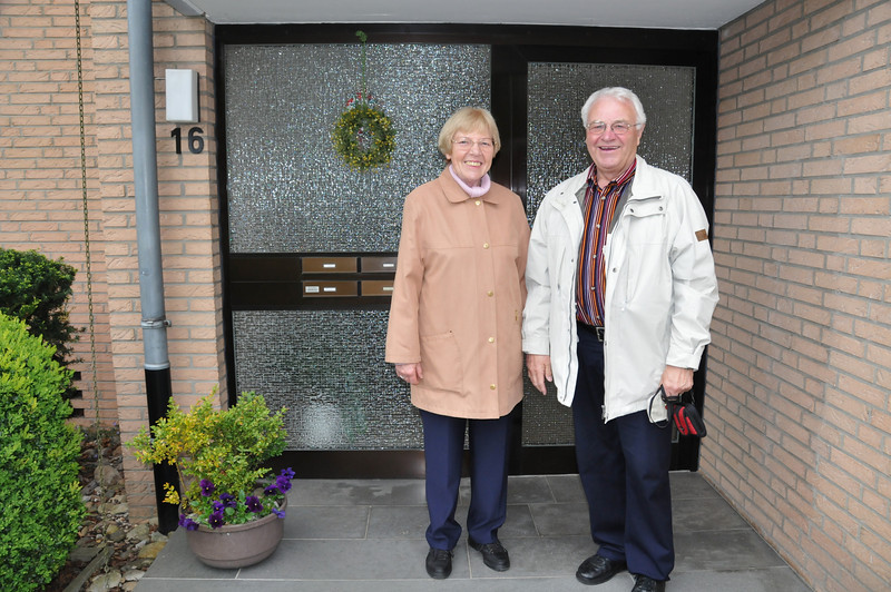 Gregor and his wife Imgard at their front door.