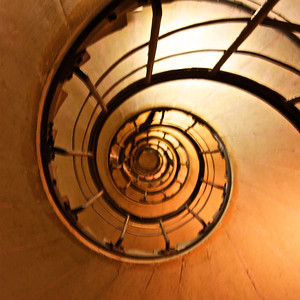looking up the stairwell of Arc de Triomphe