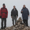 On the second day of the trip it rained. But that didn't stop four of us from heading out. At the time this photograph was taken it had started snowing. Roger, Anthony and Dennis A..