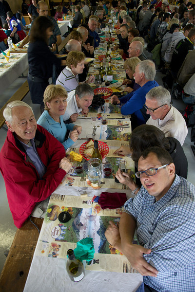 Lunch at the Foire annuelle de La Compôte en Bauges. (Annual Fair in the township of La Compôte, pop 217.)<br /> Left, from front (brackets if their face is mostly obscured): Richard, Wendy, Pippa, Carmel, (John), (Sarah), Mark C., (Inez)<br /> Right, from front: Dennis A., (Marie-Helene), Roger, Frank, Pauline, Dennis T., (Rhonda), Patricia, Mark T.