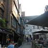 The ourtyard of our hotel, the Bourgandisch Cruyce with the archway opening out on to Wollestraat.