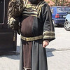 Falconer in  traditional costume with Eurasian Eagle Owl named Rosa on street leading up to Karlstejn Castle.