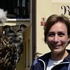 Kim with Eurasian Eagle Owl named Rosa on street leading up to Karlstejn Castle.