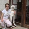 Kim with dog statue at our hotel in Lido, Albergo Quatro Fontane