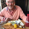 Alan with fish and chips and mushy peas in the pub.