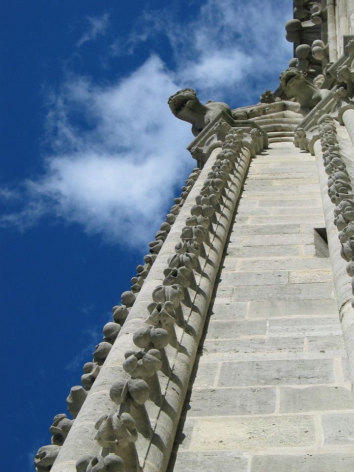 <b>Various gargoyles running up a bell tower on Notre Dame.</b>