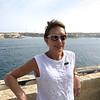 Kim  along St. Elmo's Bridge overlooking Valletta Grand Harbor.