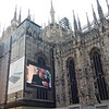 The scaffolding for maintenance of the Milan Cathedral was thoughtfully covered in canvas painted to appear like the actual cathedral.  However on top of that were advertising screens where various unrelated advertisements played continuously.