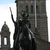 Statue of Queen Victoria on her horse in front of Glasgow Town Hall.