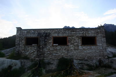 The original bath house is still there. There were 3 rooms. Each with its own bath. The water fills up the tubs and then drains out the front.  You can see the water draining from this view.