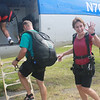Kim getting into the plane that she is planning to jump out of.