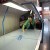 Alex at Air-Hockey at the go-cart track.