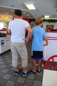 We don't know these people.  I took the photo because the dad is wearing man-capris, and his 10-year old son is wearing a beck tee.
