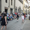 Italians watching their match on a TV in the street