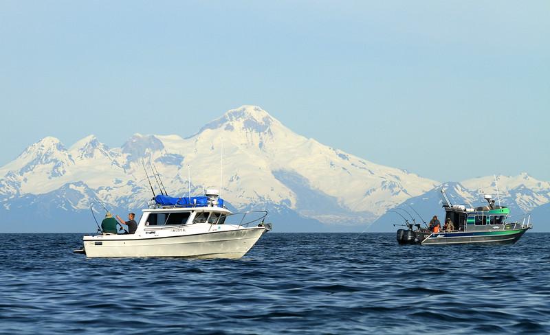 Fishing boats and Iliamna volcano