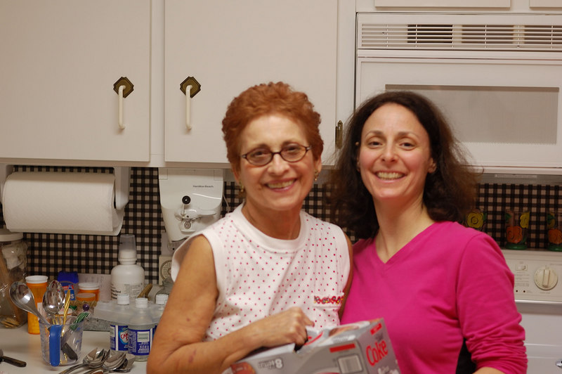 Norma and Lynn taking a break from kitchen duties to smile for the camera. Lynn has her eyes open for this one.