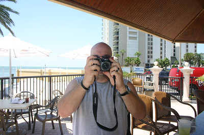Kevin trys to take a picture by the pool in Florida ( 2011 )