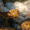 Close-up of the clear water rushing over limestone rocks.