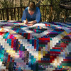 Sandy made room on the porch deck to spread out her quilt for marking.