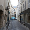 In front of the Kurtzweil apartment looking toward Saint Sulpice Church. The apartment is in a building of a district constructed in the 1700s. The narrow cobblestone street is obviously a one way traffic pattern.