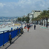 The Promenade des Anglais along the beach in Nice goes all the way west to the airport - originally built to avoid getting one's shoes dirty - now populated with walkers, runners, cyclists and in-line skates.
