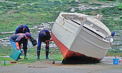 Boat repairs at low tide, Normandy, France