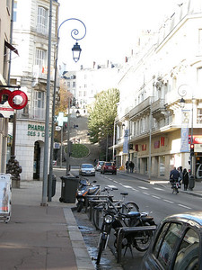 Blois is built on a bluff, with many steep streets and stairways. Note motorbikes, small cars, pedestrians, and cyclist. Definite diversity in transportation options, all quite nicely integrated.