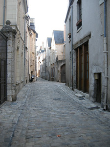 One of many small winding streets in the medieval part of Blois. These streets bar all motor vehicles excepting those of residents, but allow bicycles. Very very cool.
