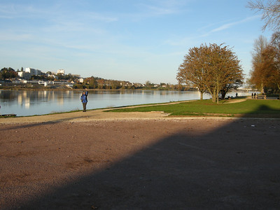 4th photo of pan, with Michele waving from the path alongside the Loire, the path there for both pedestrians and cyclists.
