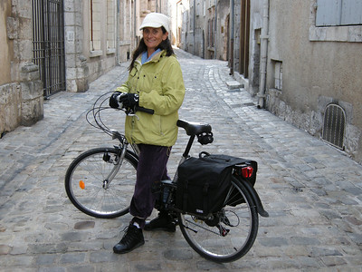 """The bike babe! One of many old streets in Blois where vehicular traffic is banned """"sauf velos"""" (except for bicycles.)"""