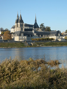 Foreground building is the old hospital of Blois, and spires are of the Eglise Saint-Nicolas (church.) From the south bank of the Loire.