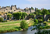 The fortified city of Carcassonne and the Pont Vieux crossing the Aude river