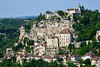 The town below the complex of monastic buildings and pilgrimage churches, traditionally dependent on the pilgrimage site and now on the tourist trade, lies near the river on the lowest slopes; it gives its name to Rocamadour, a small goat's milk cheese that was awarded AOC status in 1996.